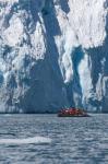 Zodiac with iceberg in the ocean, Antarctica