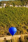 Elevated view of hot air balloon over Dordogne River Valley, Castelnaud-la-Chapelle, Dordogne, Aquitaine, France